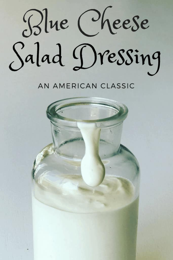 blue cheese dressing in a glass jar, with it dripping over the side