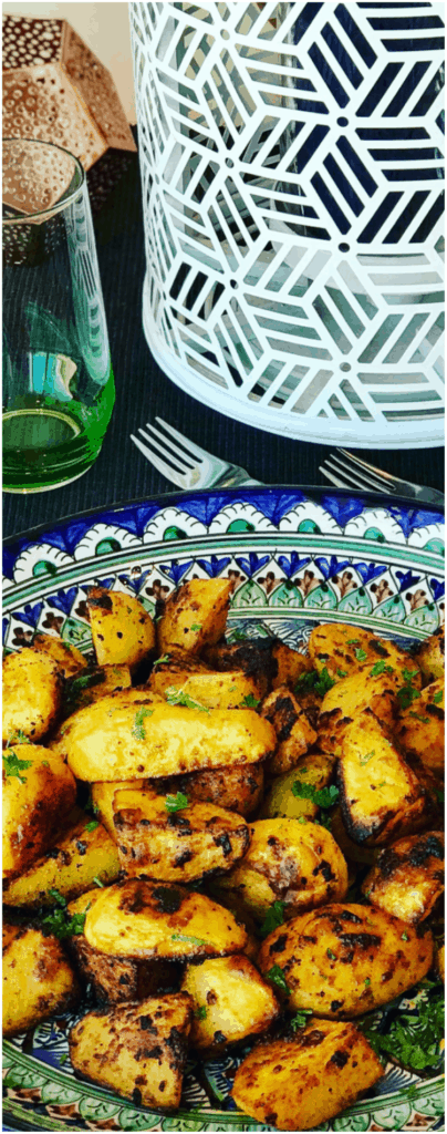 So easy to make this side dish of crispy roasted potatoes, jam packed with spices like cumin, paprika, turmeric and optional spicy Harissa! No par-boiling, just crispy roasted on a baking sheet, perfect with your roast chicken dinner or a tagine meal! Easy Roasted Moroccan Potatoes
