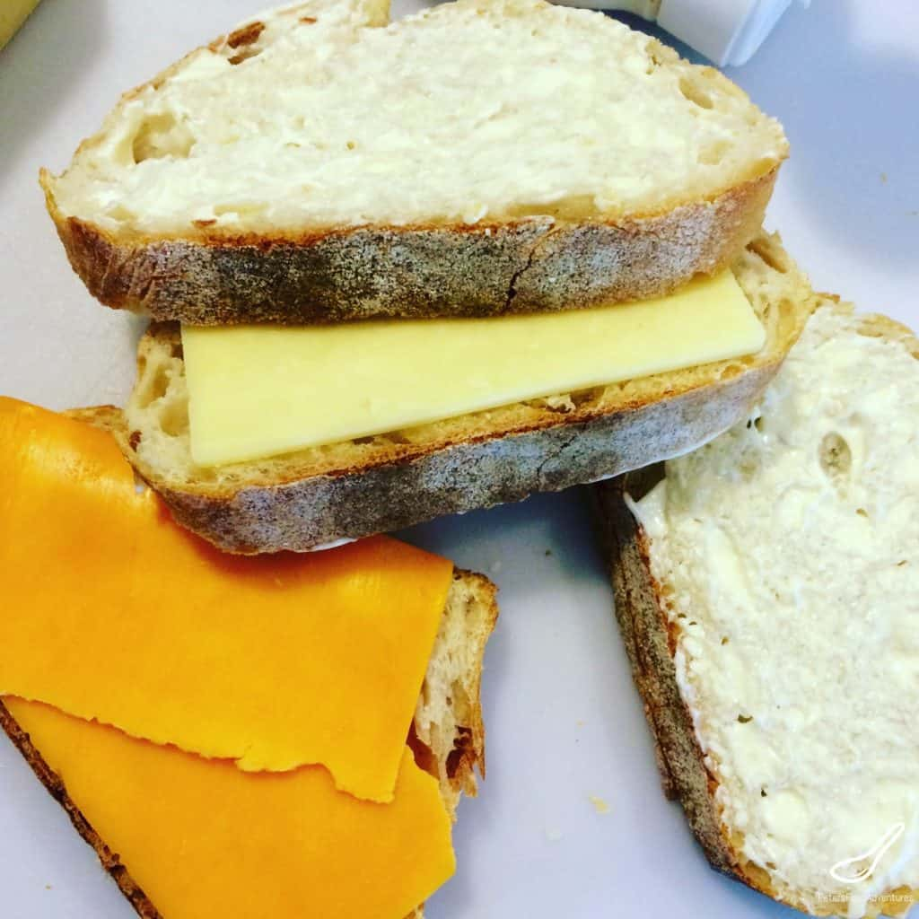 making grilled cheese sandwiches with mayo