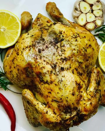 Juicy Whole Roasted Chicken, stuffed with lemon, garlic and rosemary. You won't go wrong with this easy chicken recipe that's baked upside down for maximum flavor. Winner Winner Chicken Dinner!