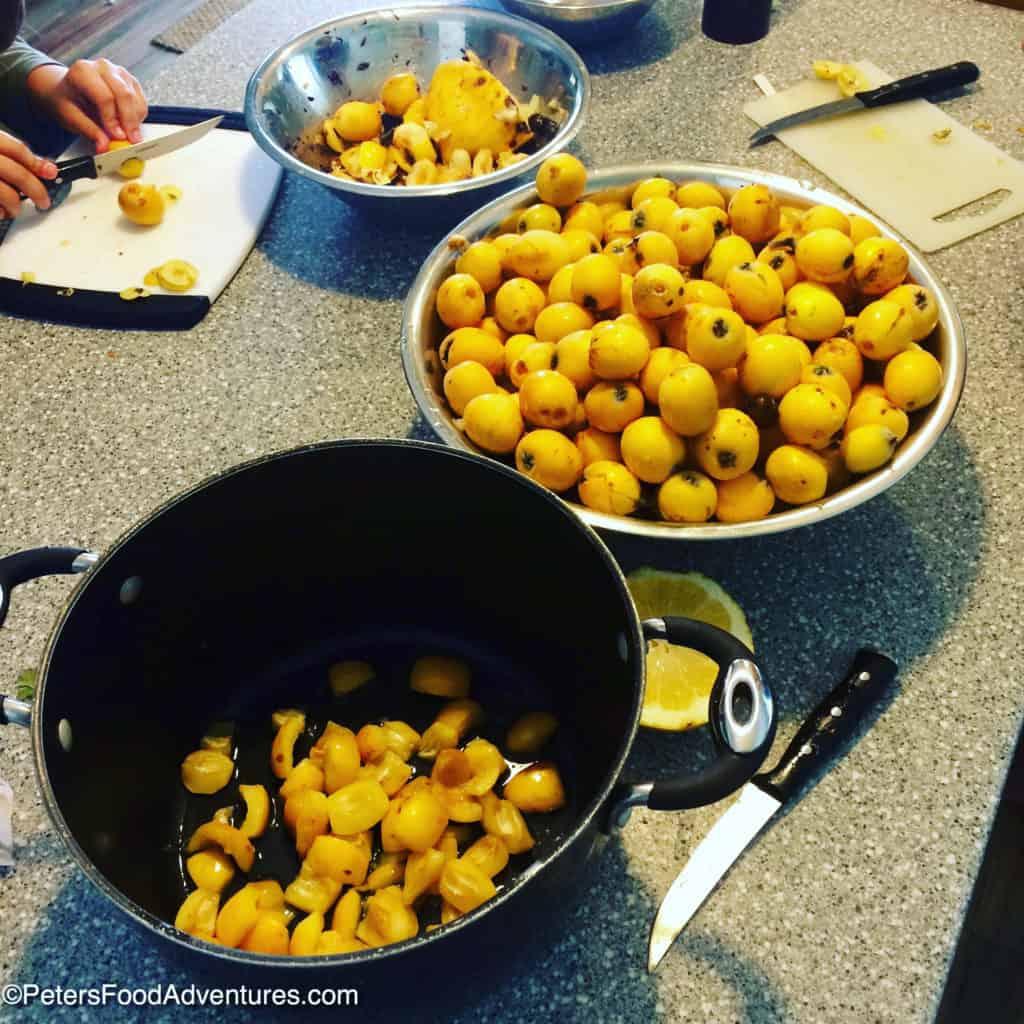 preparing loquats in a pot for jam