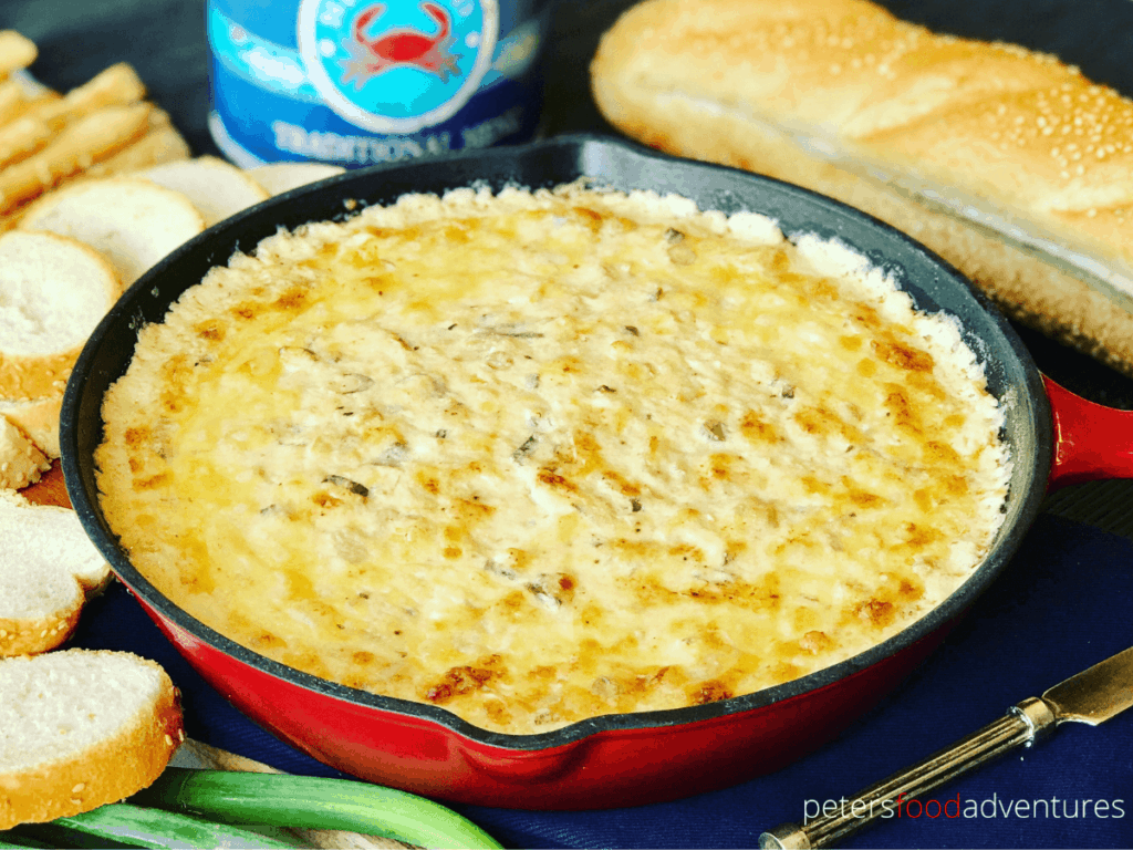 Hot Baked Crab and Artichoke Dip, Super Cheesy! Easy to make, leaving you wanting more. The perfect appetizer for party food! Crab Artichoke Dip