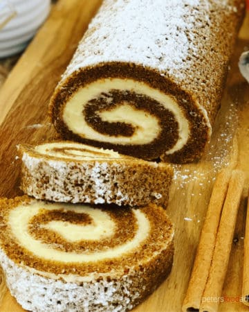 Pumpkin Roll is the perfect holiday treat for Thanksgiving or Christmas! A moist pumpkin Swiss Roll, made with pumpkin pie spice and covered in sweet cream cheese. A perfect holiday treat.