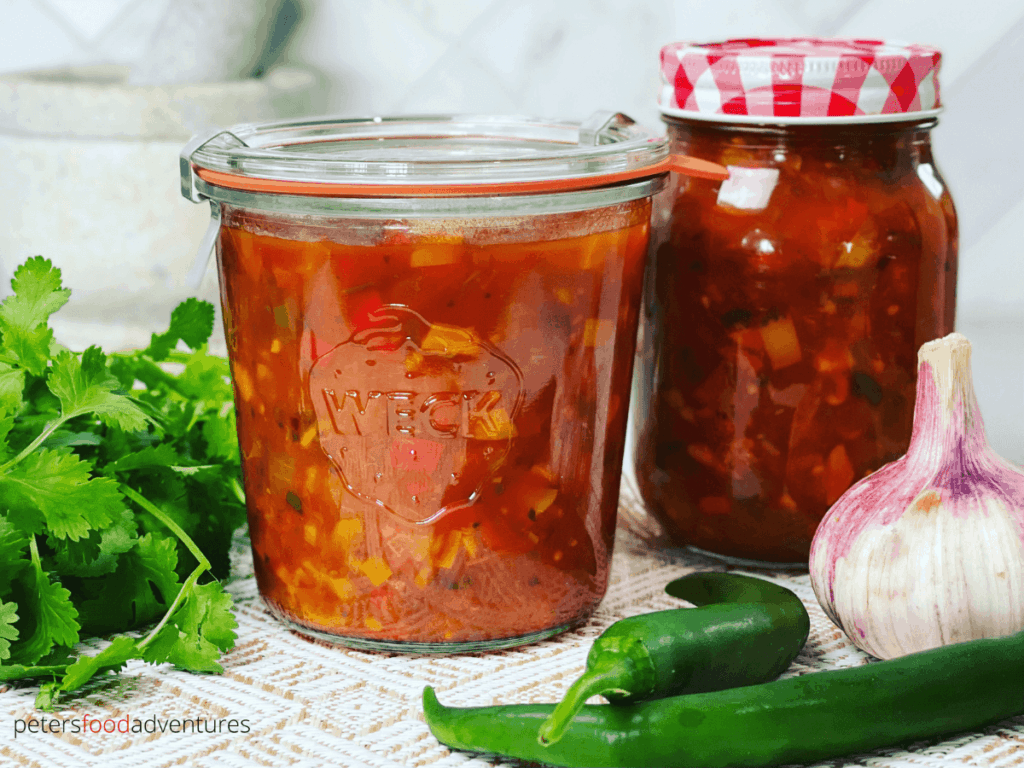 Full of flavor with smokey chipotles, garden fresh tomatoes and sweet chili peppers. A chunky chipotle salsa recipe that's perfect for canning.