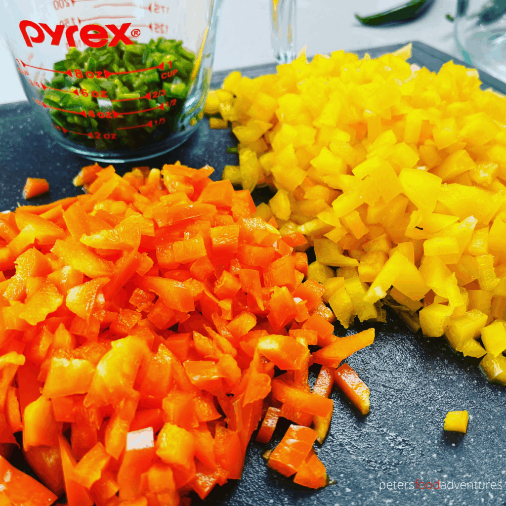 diced orange bell peppers on a cutting board