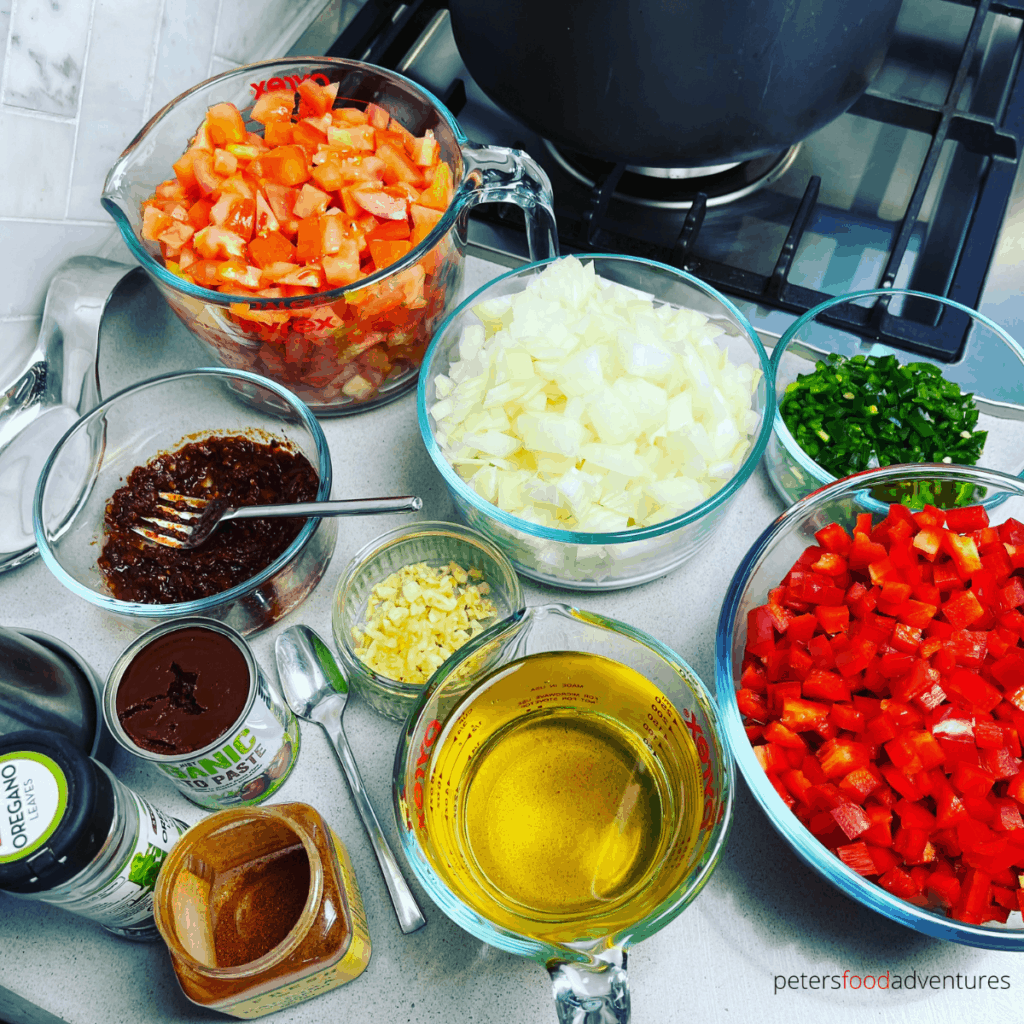 salsa ingredients prepped in glass bowls