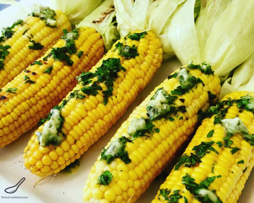 Grilled Corn in Husks covered in fresh herb butter