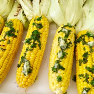 Grilled Corn on the Cob in Husk smothered in herb butter