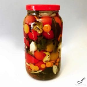 Jar of Pickled Tomatoes with Vegetables