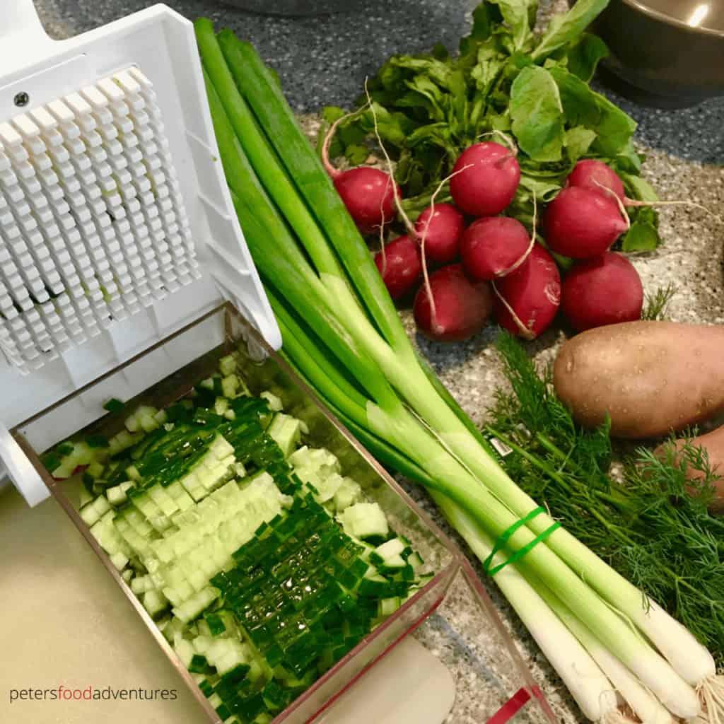 chopping cucumbers okroshka