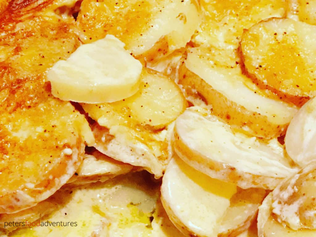 A tasty sidedish that's full of flavor! Creamy Scalloped Potatoes has Parmesan Cheese, whipping cream, garlic, mustard powder, nutmeg and butter. Easy to make, everyone will love this potato bake recipe!