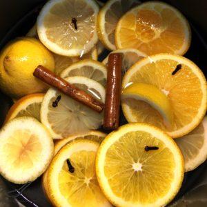 Orange and lemon sliced with cloves and cinnamon sticks