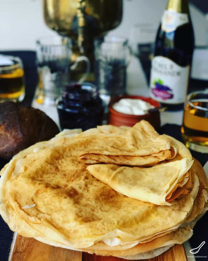 Almost time for Maslenitsa, or Pancake Week, by which we mean BLINI!!! 🥞These Russian Pancakes (Блины) commonly known as Blinchiki, Crepes, Blintzes or Blini are a staple food in many Slavic countries. Often they are stuffed and rolled. I love eating them with butter, sour cream and blueberry jam.