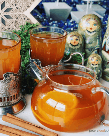 Russian Tea made from scratch, using real tea bags, oranges, lemons and spices. This delicious Orange spiced Russian tea recipe is easy to make and a winter treat - Spiced Russian Tea Recipe