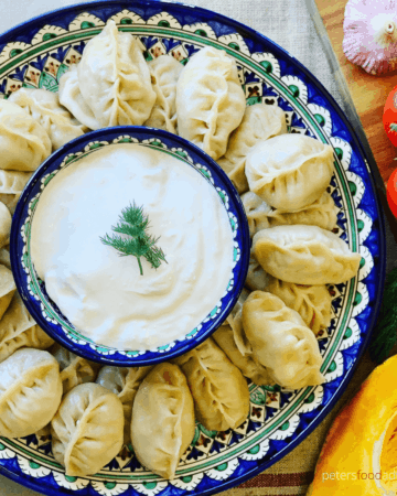 Uyghur Manti Steamed Dumplings made with ground beef and pumpkin. Popular across Russia, Kazakhstan and Uzbekistan. Delicious with sour cream - Manti (Манты)