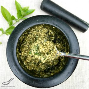 Homemade Pesto in a Mortar and Pestle with fresh basil