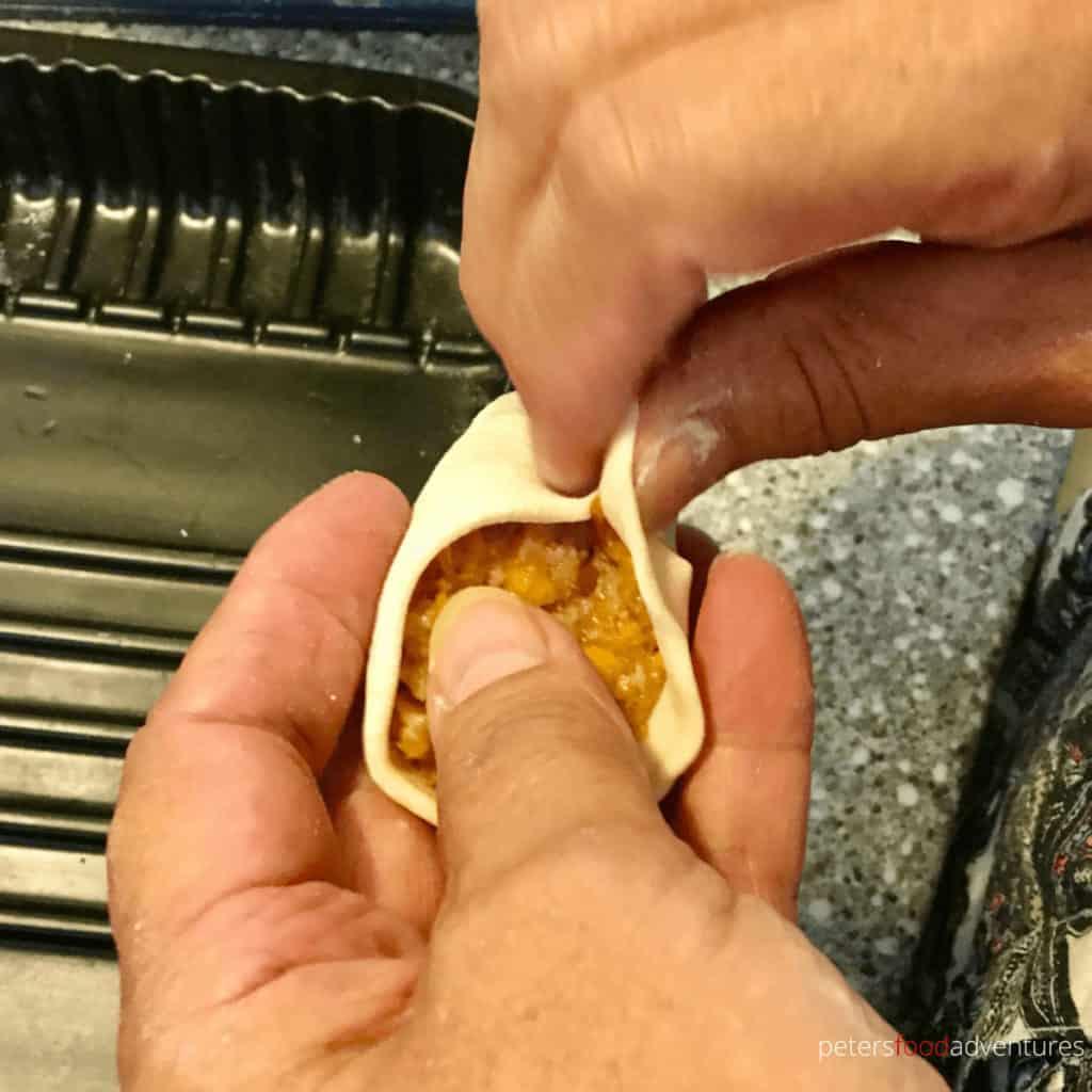making manti, pinching them sealed