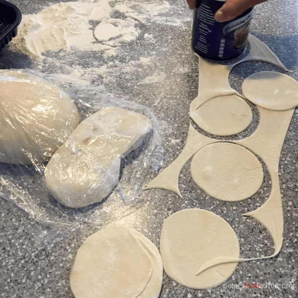 cutting dough circles for manti using a can
