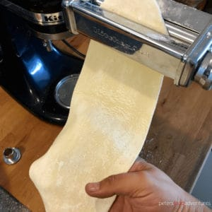 rolling dough piece from a pasta roller for manti
