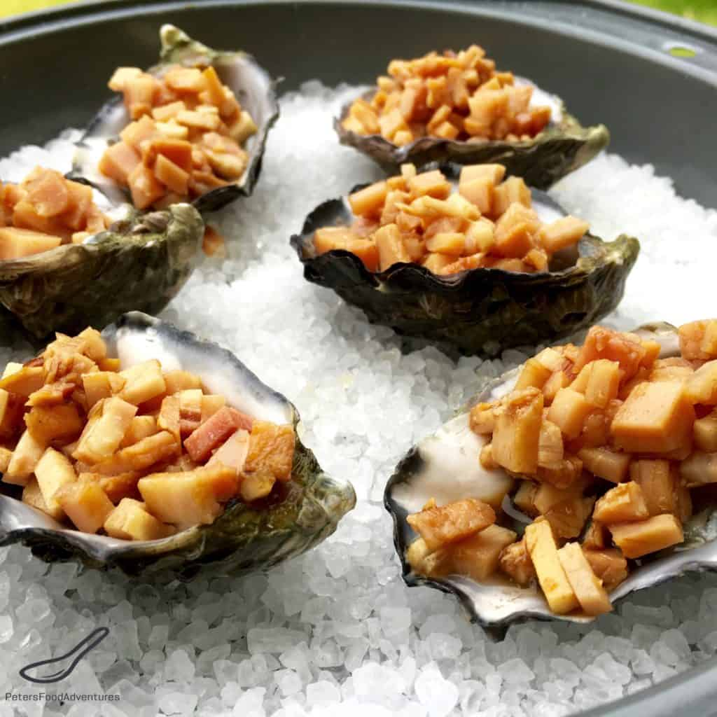 Oysters Kilpatrick on a baking tray