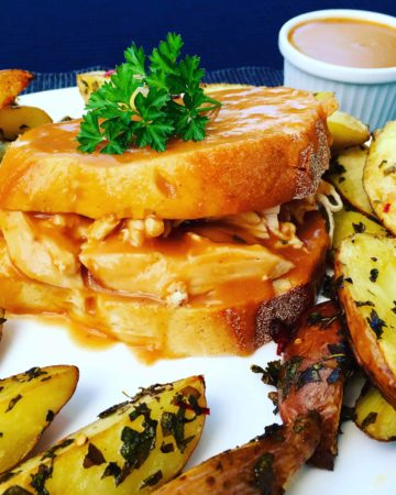 Hot Chicken Sandwich Recipe - A recipe inspired by Swiss Chalet, shredded rotisserie chicken smothered in gravy. It's my favorite messy chicken sandwich, perfect for an easy dinner.