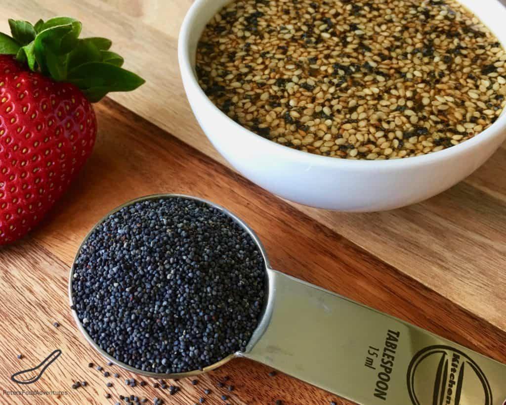 Poppy Seed Salad Dressing beside a teaspoon of Poppy Seeds