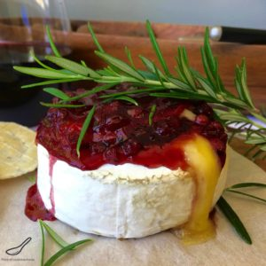 Baked Brie with Cranberry or Lingonberry Sauce (брусника). I love this classic holiday appetizer. Quick and easy to make, sweet and savory combined with melted gooey cheese.