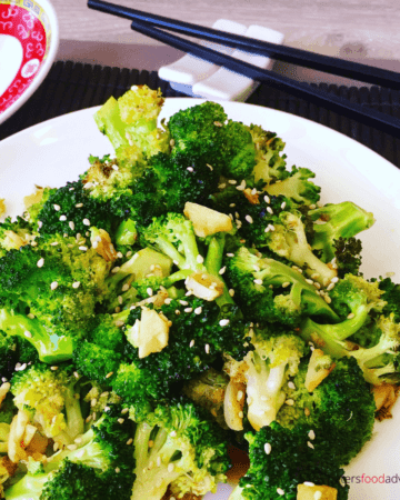 Oven Roasted Broccoli with Garlic and Soy Sauce is healthy, easy and delicious. Chinese style, roasted with garlic, flavorful and packed full of vitamins. The best broccoli side dish you'll ever make!