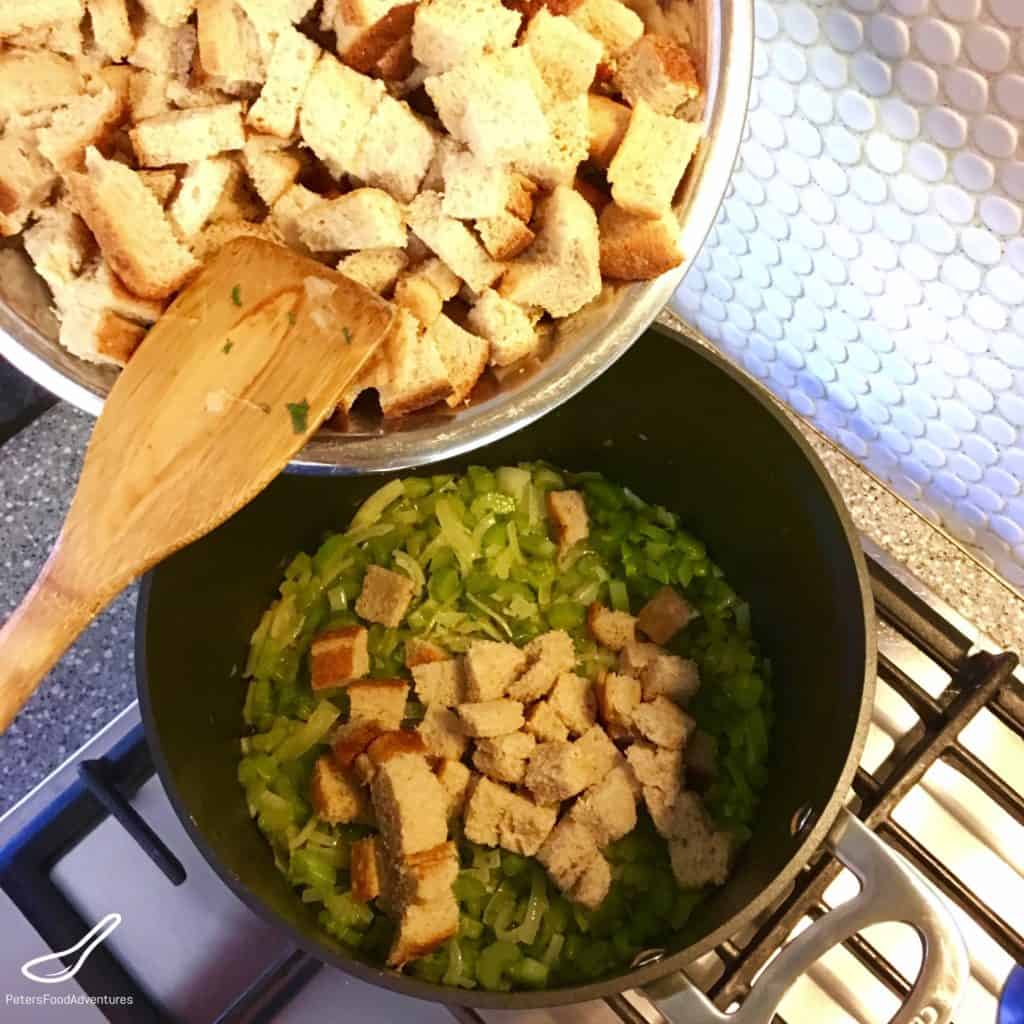 bread cubes placed into saucepan with celery