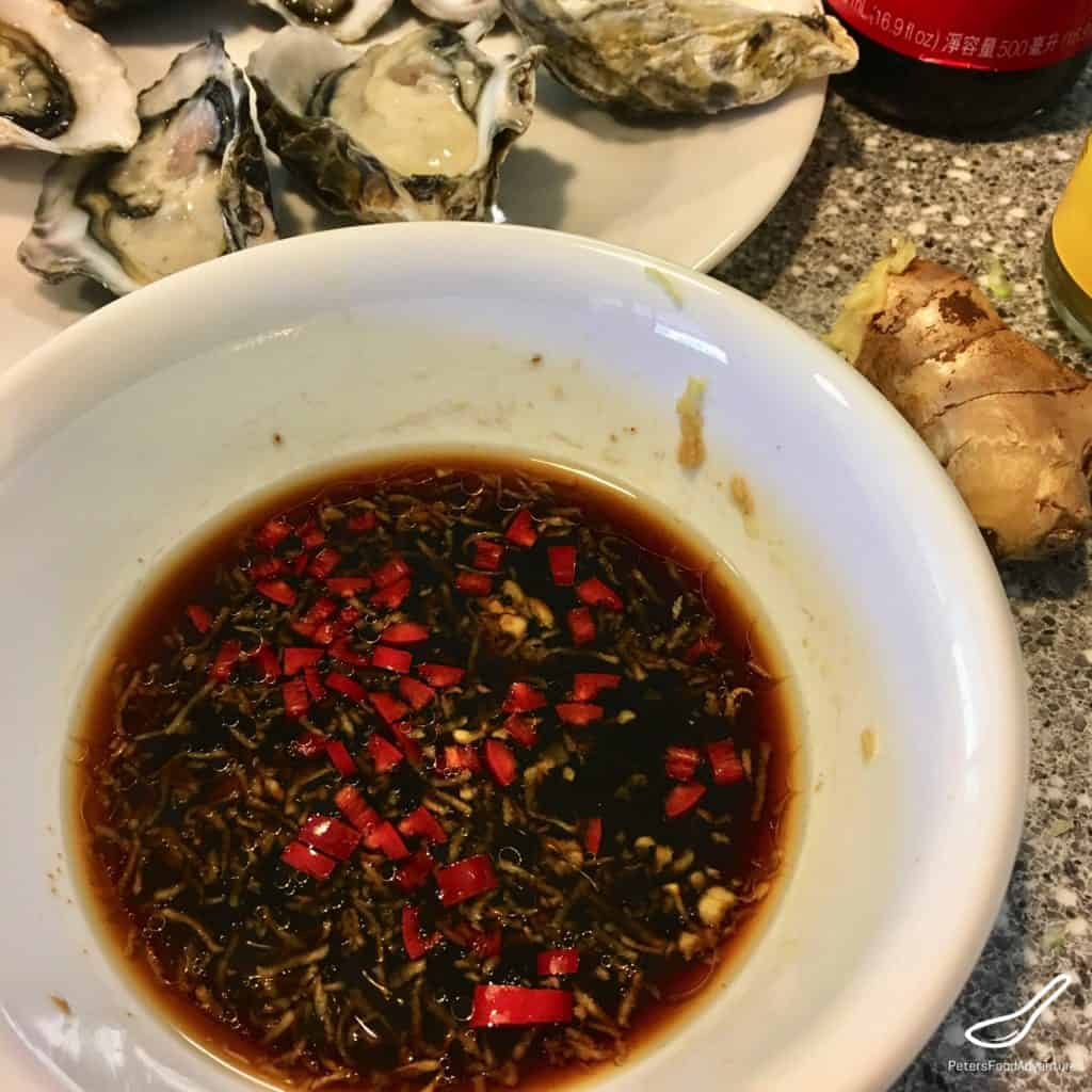 oyster dressing with fresh chili peppers in a bowl