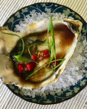 Freshly shucked oysters drizzled with an Asian vinaigrette, with fresh chili pepper and grated ginger. You'll definitely fall in love with my Asian Dressed Oysters