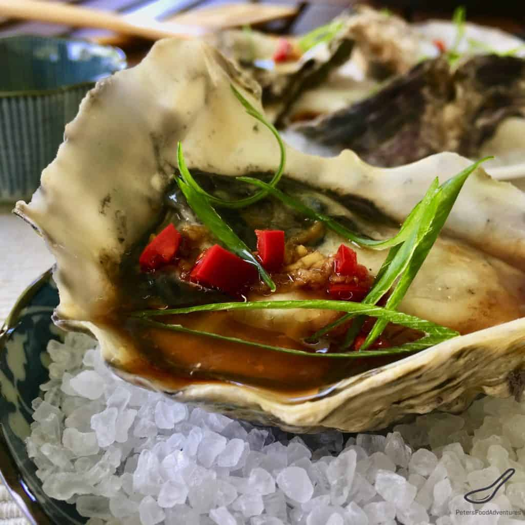 Oyster Dressing drizzled with an Asian vinaigrette, with fresh chili pepper and grated ginger