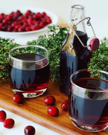 A homemade Cranberry Juice recipe that's delicious and refreshing. Made from whole cranberries, full of vitamins, sweetened with sugar or honey. A perfect summer drink, or holiday treat. Cranberry Mors Drink (морс)