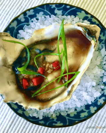 Freshly shucked oysters drizzled with an Asian vinaigrette, with fresh chili pepper and grated ginger. You'll definitely fall in love with my Asian Oyster Dressing!