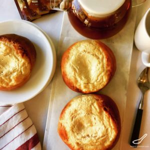 A baked yeast sweet buns filled with sweet cheese Tvorog, Farmer's Cheese or Quark. Part Russian cheesecake, part Russian brioche bun (сдобное sdobnoe), delicious and healthy. Vatrushki Sweet Cheese Buns (Ватрушки)