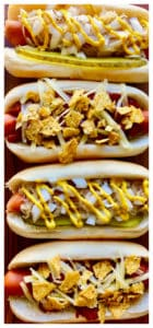 Hot Dogs with various toppings lined up in a row