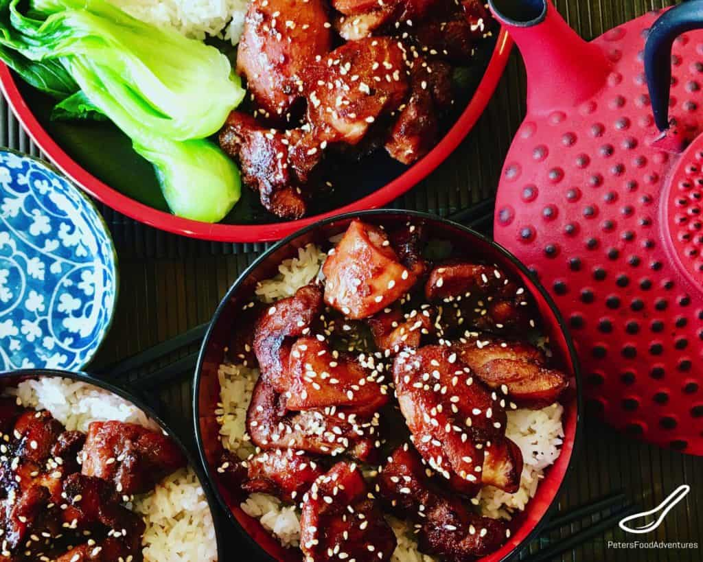 Teriyaki Chicken over rice beside a Japanese teapot