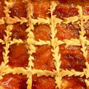 A rustic treat with sweet homemade apricot jam, generously spread on a Russian sweet yeast dough called Sdobnoe (сдобное тесто). Not your ordinary pie pastry, almost a cake or slice, so delicious and so Russian - Apricot Pirog Pie (Пирог из дрожжевого теста с вареньем)