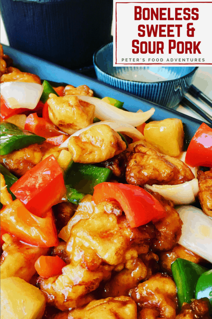 A classic food court style Boneless Sweet and Sour Pork in a crispy batter. The sauce is so easy to make with the sweetness of ripe pineapple, bell peppers and onion. Tastes just like take out! Classic Asian American Sweet and Sour Pork