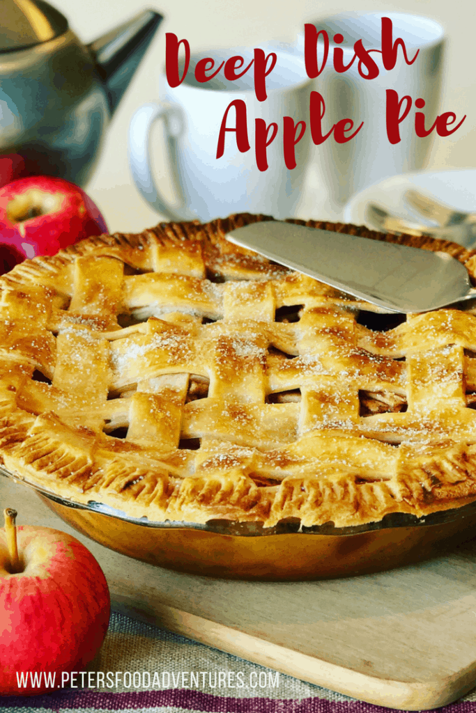 apple pie in a glass baking dish with a lattice dough crust