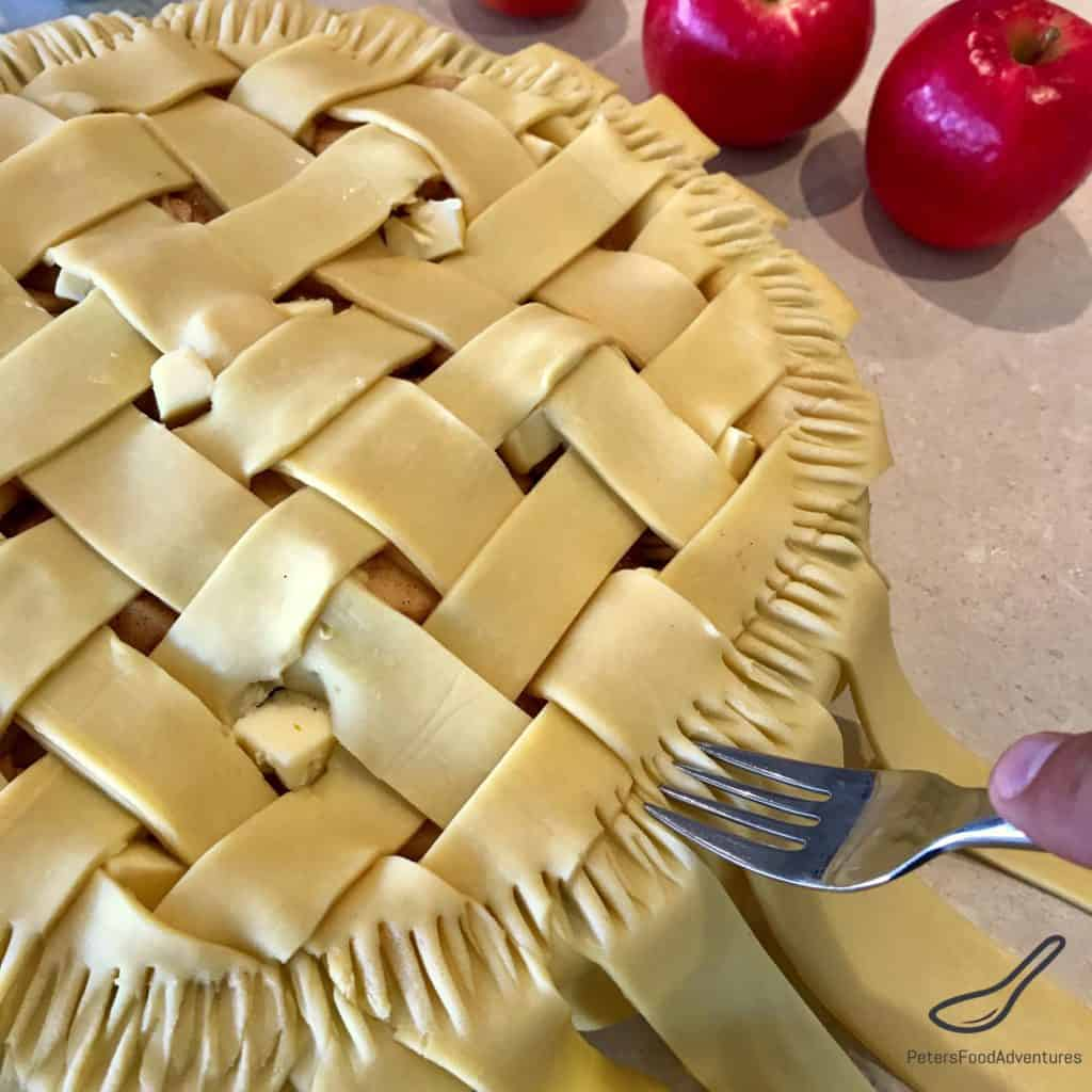 Pressing Apple Pie edges with a fork