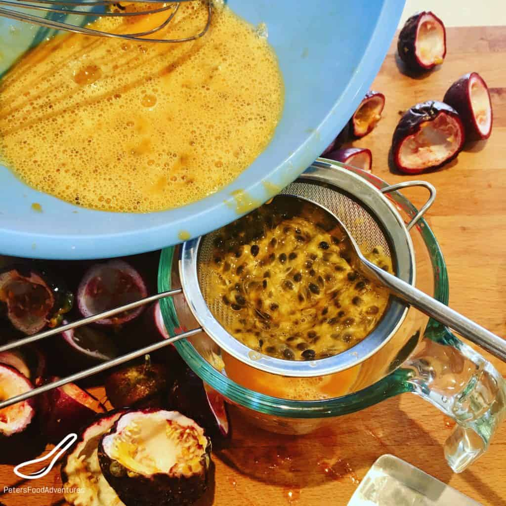 Passionfruit Curd being strained in a sieve