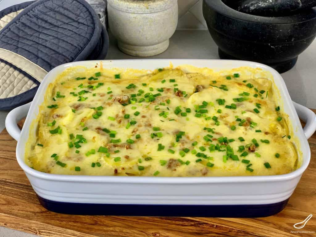 Creamy Potato Bake French Onion Soup is super easy and a creamy, cheese scalloped potato casserole that only uses 4 ingredients. So easy to make, yet packed full of flavor. Using the dry French Onion Soup mix