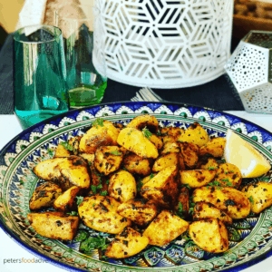 Moroccan Roasted Potatoes are so easy to make. A perfect side dish of crispy roasted potatoes, jam packed with spices like cumin, paprika, turmeric and optional spicy Harissa! No par-boiling, just crispy roasted on a baking sheet or Air Fryer, perfect with your roast chicken dinner or a tagine meal!