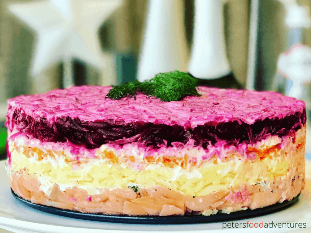 Shuba Salad is traditionally made with Herring, but I think it tastes even better with Salmon! A layered Russian potato salad with beets, carrots, eggs, potatoes, dill and smoked salmon. A bright and hearty salad that looks like a cake! Especially popular at celebrations like New Years and Christmas.