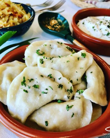 Vareniki Dumplings with Farmer's Cheese. A comfort food popular in Russia, Ukraine and Eastern Europe. Known as Perogies, Pierogi, Pirohy and more... Slather generously with butter and sour cream.