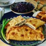 Chebureki are a classic Crimean, Caucasus and Turkic street food snack, popular across Russia and the former Soviet Union. Crispy outside, juicy inside, so easy to make, an authentic recipe! Chebureki (Чебуреки)