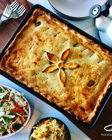 This Beef Pirog recipe is made with potatoes, red peppers and green onions. One of the many Pirog recipes your family can enjoy for dinner. An easy unleavened dough recipe that can be prepared in advance. A perfect Russian meat pie!