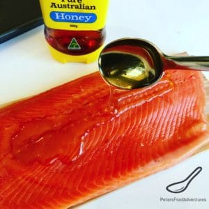Spreading honey on trout fillet