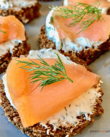 An easy to make appetizer, ready in minutes! Smoked Salmon, dill cream cheese on rye bread rounds (or pumpernickel). This simple 4 ingredients recipe is the perfect salmon canape for the holidays. Smoked Salmon Appetizers